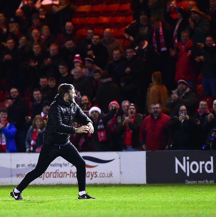 Lincoln City's assistant manager Nicky Cowley celebrates the victory with fans<br /> <br /> Photographer Andrew Vaughan/CameraSport<br /> <br /> The EFL Sky Bet League Two - Lincoln City v Newport County - Saturday 22nd December 201 - Sincil Bank - Lincoln<br /> <br /> World Copyright © 2018 CameraSport. All rights reserved. 43 Linden Ave. Countesthorpe. Leicester. England. LE8 5PG - Tel: +44 (0) 116 277 4147 - admin@camerasport.com - www.camerasport.com