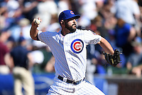 Chicago Cubs pitcher Carlos Villanueva (33) delivers a warmup pitch during a game against the Milwaukee Brewers on August 14, 2014 at Wrigley Field in Chicago, Illinois.  Milwaukee defeated Chicago 6-2.  (Mike Janes/Four Seam Images)
