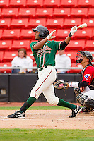 Isaac Galloway #24 of the Greensboro Grasshoppers follows through on his swing against the Hickory Crawdads at L.P. Frans Stadium on May 18, 2011 in Hickory, North Carolina.   Photo by Brian Westerholt / Four Seam Images