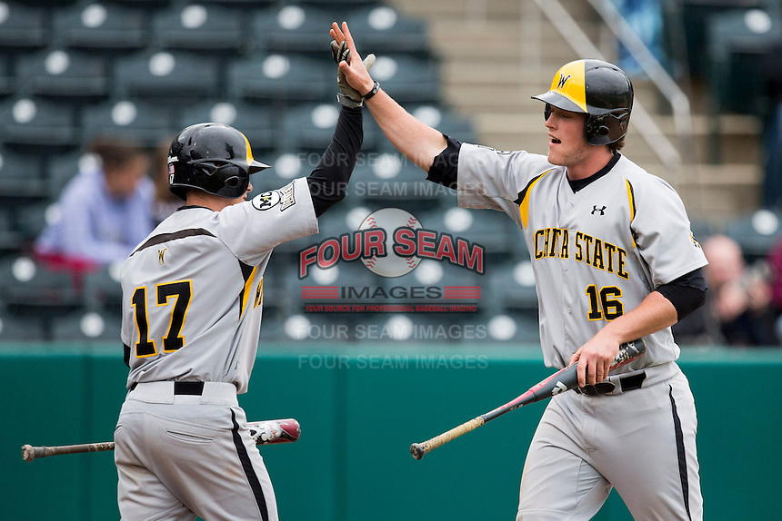 Casey Gillaspie #16 of the Wichita State Shockers high fives Tyler Baker #17 of the Wichita State Shockers after scoring a run during a game against the Missouri State Bears at Hammons Field on May 5, 2013 in Springfield, Missouri. (David Welker/Four Seam Images)
