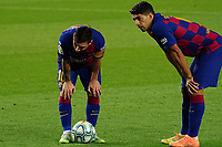 16th July 2020; Camp Nou, Barcelona, Catalonia, Spain; La Liga Football, Barcelona versus Osasuna; Leo Messi and Luis Suarez over the ball in minute 62 as Messi is about to take and score for 1-1