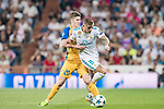 Toni Kroos (r) of Real Madrid battles for the ball with Roland Sallai of APOEL FC during the UEFA Champions League 2017-18 match between Real Madrid and APOEL FC at Estadio Santiago Bernabeu on 13 September 2017 in Madrid, Spain. Photo by Diego Gonzalez / Power Sport Images