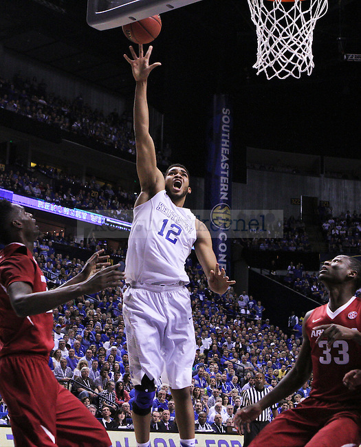 Kentucky guard Karl-Anthony Towns shoots the ball during the first half of the Championship game of the SEC tournament against Arkansas in Nashville , Tenn., on Sunday, March 15, 2015. Photo by Jonathan Krueger | Staff