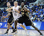 November 11, 2011:   Air Force forward, Taylor Stewart (15), fights for position during the opening game of the All Military Classic between the Army Black Knights and the Air Force Falcons at Clune Arena, United States Air Force Academy, Colorado Springs, CO.  Air Force defeats Army 87-71in the season opener for both teams.