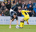 Dundee's Thomas Konrad is fouled by St Mirren's Jason Naismith.