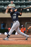 Pulaski Mariners first baseman Yordi Calderon #22 swings at a pitch during a game against the Greenville Astros at Pioneer Park July 12, 2014 in Greenville, Tennessee. The Mariners defeated the Astros 11-10. (Tony Farlow/Four Seam Images)