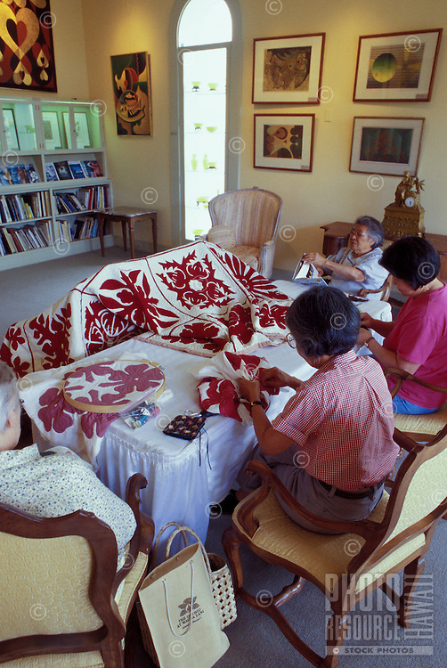 Women stitching a Hawaiian quilt in a historical home at Parker Ranch on the Big Island