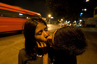 "Street teenagers Julio and Aura make out in Guatemala City's Zone 8. Pilar Lopez, coordinator of Medicos Sin Fronteras, said street kids often come to her clinic with sexually transmitted diseases. Many of ""los niños de la calle,""--the children of the streets--are addicted to paint thinner, soaking balls of cloth with it and holding the toxic rags to their mouths. The children and young adults prefer solvent to glue because it is cheaper and helps them forget their hunger pains and cold. Carlos Toledo, director and founder of Nuestros Derechos--Our Rights- a Guatemalan non-governmental organization that tries to help the children off the streets and into society, said there are about 10,000 children living without homes or stable lives in Guatemala. ""These children are illegal in their own country,"" Toledo said, since most have no legal documentation and are not recognized as existing by the government."