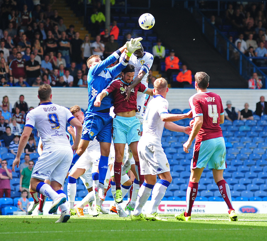 Leeds United's Marco Silvestri punches clear under pressure from Burnley's George Boyd<br /> <br /> Photographer Chris Vaughan/CameraSport<br /> <br /> Football - The Football League Sky Bet Championship - Leeds United  v Burnley - Saturday 8th August 2015 - Elland Road - Beeston - Leeds<br /> <br /> &copy; CameraSport - 43 Linden Ave. Countesthorpe. Leicester. England. LE8 5PG - Tel: +44 (0) 116 277 4147 - admin@camerasport.com - www.camerasport.com
