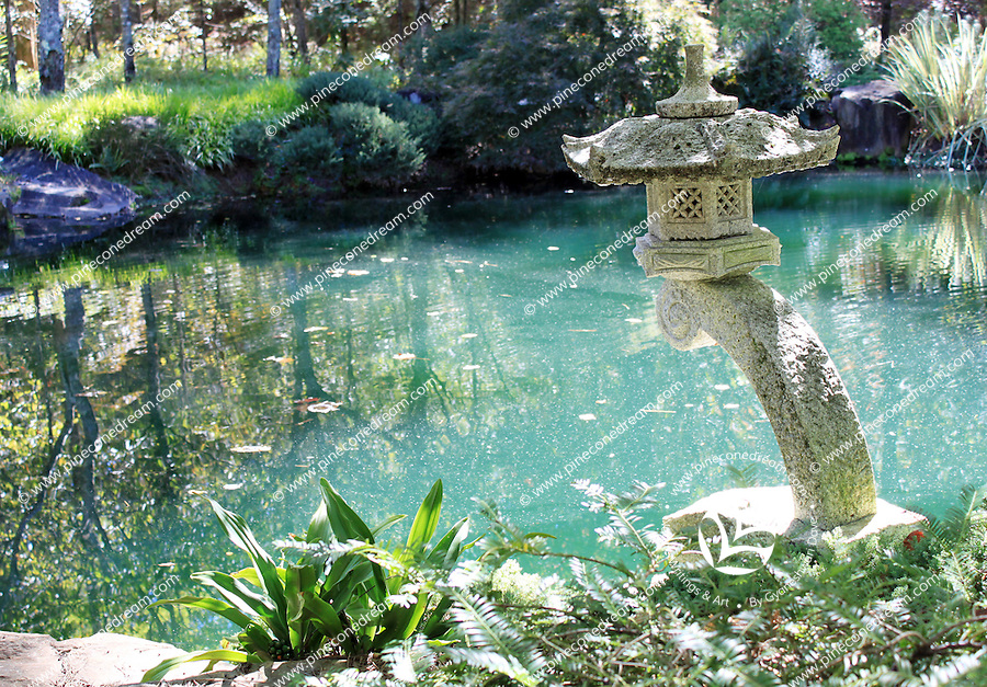 Stock photo: Beautiful sculpture overlooking a small pond in the Gibbs garden Georgia USA.