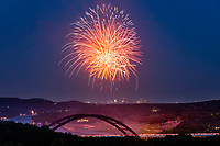 In this image, Fireworks light up the night sky over the 360 Pennybacker Bridge in west Austin, Texas on the 4th of July.