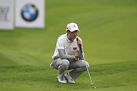 Ouyang Zheng (CHN) on the 16th green during Friday's Round 2 of the 2014 BMW Masters held at Lake Malaren, Shanghai, China 31st October 2014.<br /> Picture: Eoin Clarke www.golffile.ie