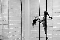 Carolina Echavarria, a young Colombian pole dancer, performs pole tricks during a training session in Academia Pin Up in Medellín, Colombia, 25 February 2016. Pole dance, a performance combining sport with art and merging dance with acrobatics on a vertical pole, has reached wide popularity in Latin America in the last decade. With dance and physical attraction being a natural way of expression for many Latinas, thousands of women take pole dancing classes in gyms and dance studios, as a form of fitness and social entertainment.