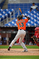 Miami Marlins Jorge Caballero (13) at bat in front of catcher Alex Dunlap (27) during a Florida Instructional League game against the Washington Nationals on September 26, 2018 at the Marlins Park in Miami, Florida.  (Mike Janes/Four Seam Images)