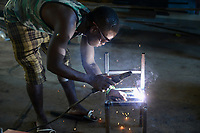 UGANDA, Kampala, Kampiringisa, national rehabilitation center, a juvenile-detention facility for children and young people, vocational training in metal workshop / Jugendhaftanstalt und Rehabilitationszentrum Kampiringisa, Berufsausbildung in Metall Werkstatt