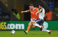 Blackpool's Oliver Turton under pressure from Bolton Wanderers' Jason Lowe<br /> <br /> Photographer Kevin Barnes/CameraSport<br /> <br /> The EFL Sky Bet League One - Bolton Wanderers v Blackpool - Monday 7th October 2019 - University of Bolton Stadium - Bolton<br /> <br /> World Copyright © 2019 CameraSport. All rights reserved. 43 Linden Ave. Countesthorpe. Leicester. England. LE8 5PG - Tel: +44 (0) 116 277 4147 - admin@camerasport.com - www.camerasport.com