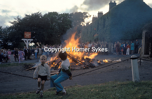 Baal or Bale Fire Whalton Northumberland UK. St Johns Eve June annually, outside Beresford Arms in centre of village. 1971 or 1972