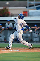 DJ McKnight (8) of the Bluefield Blue Jays follows through on his swing against the Burlington Royals at Burlington Athletic Park on June 29, 2015 in Burlington, North Carolina.  The Royals defeated the Blue Jays 4-1. (Brian Westerholt/Four Seam Images)
