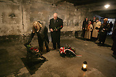 United States Vice President Dick Cheney and his daughter Liz Cheney, left, along with other members of a United States delegation, lay flowers at a memorial inside the first gas chamber at the Auschwitz-1 Nazi concentration camp, near Krakow, Poland, January 28, 2005. Vice President Cheney was there to take part in ceremonies commemorating the 60th Anniversary of the liberation of the Auschwitz camps. The Wall of Death was named for its use as the backdrop for firing squads where thousands of prisoners were executed while the camp was in operation. <br /> Mandatory Credit: David Bohrer / White House via CNP