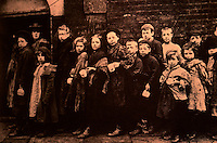 "London: Historical East End--Children lining up for ""Farthing Breakfasts"", Hanbury Street, 1880. Wm. J. Fishman, STREETS OF EAST LONDON.  Reference only."