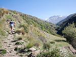 Woman walker and landscape of the River Rio Poqueira gorge valley, High Alpujarras, Sierra Nevada, Granada Province, Spain
