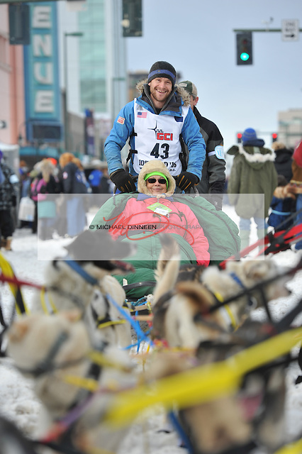 Iditarod Trail Sled Dog Race rookie Larry Daugherty of Eagle River smiles as he awaits his ceremonial start of the 1,000-mile race in Anchorage, Alaska Saturday, March 5, 2016. With Daugherty is Iditarider Salud Rodeman of Port Washington, Wisconsin.  Photo for the Star by Michael Dinneen