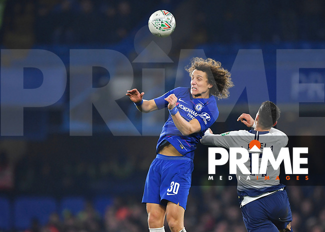 David Luiz of Chelsea and Erik Lamela of Tottenham Hotspur battle for the ball during the Carabao Cup Semi-Final 2nd leg match between Chelsea and Tottenham Hotspur at Stamford Bridge, London, England on 24 January 2019. Photo by Vince  Mignott / PRiME Media Images.