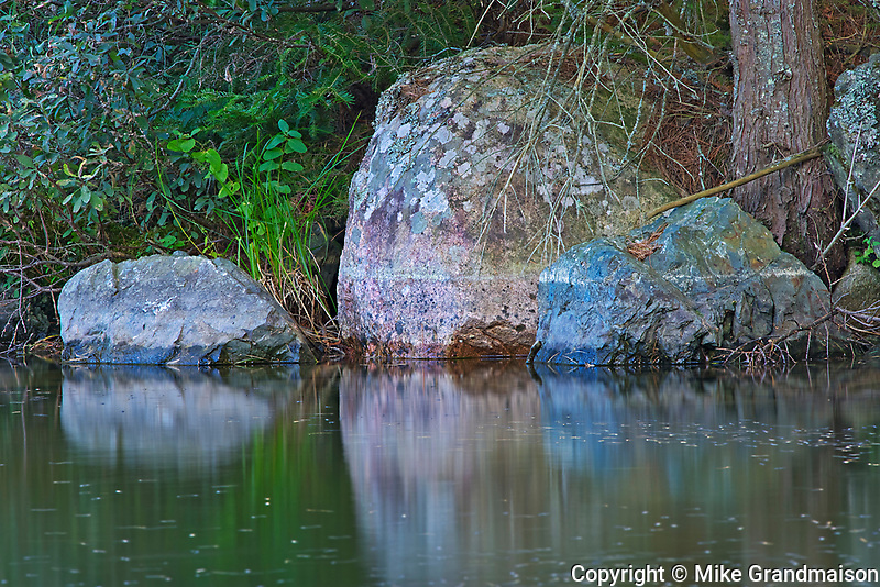 Rocks reflected in Dryberry Creek<br />Sioux Narrows<br />Ontario<br />Canada