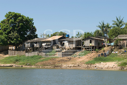 Pará State, Brazil. São Félix do Xingu. Poor riverside housing with satellite television dishes.