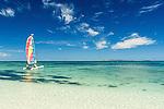 Hobie cat sailing off the beach at Treasure Island Resort in Fiji