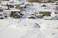 Aerial of John Baker arriving @ Nulato chkpt during 2006 Iditarod Alaska Winter