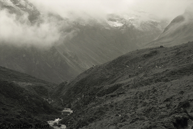 Scale in the Himalaya.  This image was taken above camp at Jhomolhari.  The solitary trekker is walking toward Jichu Drake.