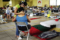 Maria Magdalena Gonzalez Perez, 46 years old, is being comforted by her daughter in the Club Campestre a temporary shelter.  Maria Magdalena lost both her sister and mother in the floods caused by huricane Stan.  Tapachula, Chiapas.