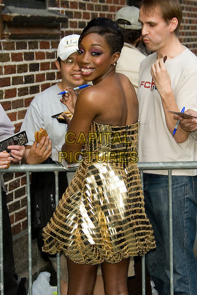 ESTELLE.Appearance on the Late Show with David Letterman.at the Ed Sullivan Theater, New York, NY, USA, April 24, 2008.half length pink eyeshadow gold sequined shiny beaded strapless dress  back over shoulder.CAP/LNC/TOM.©LNC/Capital Pictures