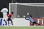 15 July 2007: Chile's Mauricio Isla (3) converts a 114th minute penalty against Nigeria goalkeeper Ikechukwu Ezenwa (21). Chile's Under-20 Men's National Team defeated Nigeria's Under-20 Men's National Team 4-0 after extra time in a  quarterfinal match at Olympic Stadium in Montreal, Quebec, Canada during the FIFA U-20 World Cup Canada 2007 tournament.