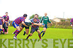 From a 5m scrum Iveragh Eagles Pa McGill drives through the defence of Castleisland's Ian Moloney & Pat Sullivan.