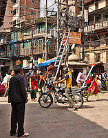 Creative wiring and an uncoroned worker attest to the electrical inconsistencies in Kathmandu, Nepal.