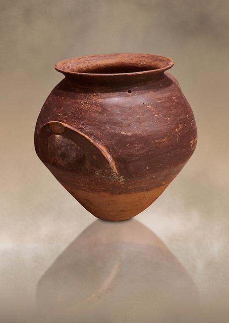 Hittite  terra cotta pot woth two handles. Hittite Period, 1600 - 1200 BC.  Hattusa Boğazkale. Çorum Archaeological Museum, Corum, Turkey. Against a warm art bacground.