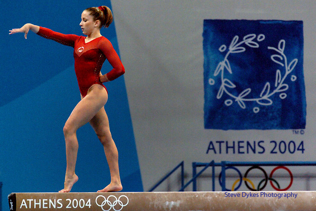 US Women's Gymnast Carly Patterson performs on the Balance Beam on her way to winning the Gold Medal in the Women's Individual All-Around final at the Indoor Hall during the 2004 Summer Olympic Games in Athens,Greece on Thursday, August 19th, 2004..         DENVER POST PHOTO BY STEVE DYKES