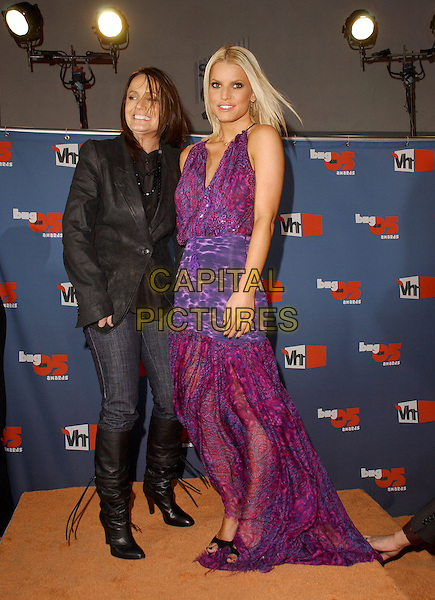 TINA SIMPSON & JESSICA SIMPSON.The VH1 Big In '05 Award Show held at The Sony Picture Studios in Culver City, California .December 3rd, 2005.Ref: DVS.full length mother daughter family purple dress black boots jeans denim jacket.www.capitalpictures.com.sales@capitalpictures.com.Supplied By Capital PIctures