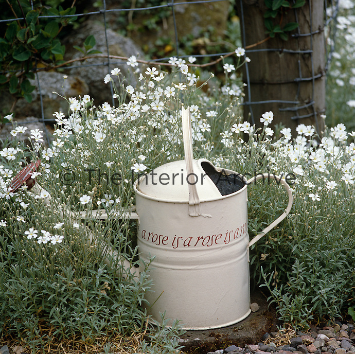 A watering can in artist Ian Hamilton Finlay's Scottish garden bears Gertrude Stein's definition of a rose