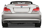 Straight rear view of a 2007 - 2011 BMW 1-Series 128i convertible.