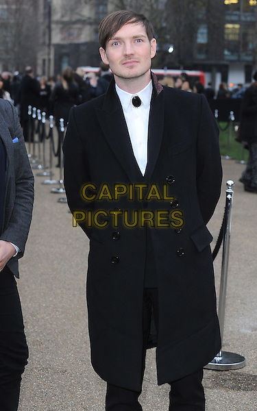 DAN GILLESPIE SELLS of The Feeling.The Burberry Prorsum Fashion Show during London Fashion Week Autumn/Winter 2011, Kensington Gardens, London, England..21st February 2011.LFW half length black white stubble facial hair coat.CAP/BEL.©Tom Belcher/Capital Pictures.