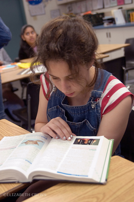 Union City CA 8th grade student using reference book to help with her composition in English class