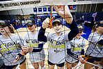PENSACOLA, FL - DECEMBER 09: Sydney Book (1) of Concordia University, St. Paul, center, cuts a portion of the net during the Division II Women's Volleyball Championship held at UWF Field House on December 9, 2017 in Pensacola, Florida. (Photo by Timothy Nwachukwu/NCAA Photos via Getty Images)
