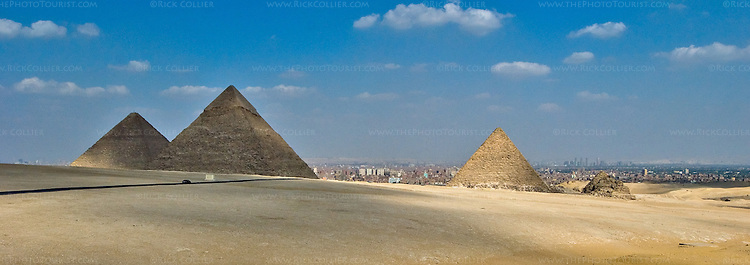 Giza, Cairo, Egypt -- Cairo serves as the backdrop for the three most famous pyramids, at Giza (viewed from the public overlook viewing site at Giza). © Rick Collier / RickCollier.com.