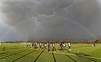 The players warm up on the pitch while a rainbow appears above them during the Swansea City Training at The Fairwood Training Ground, near Swansea, Wales, UK. Friday 19 January 2018