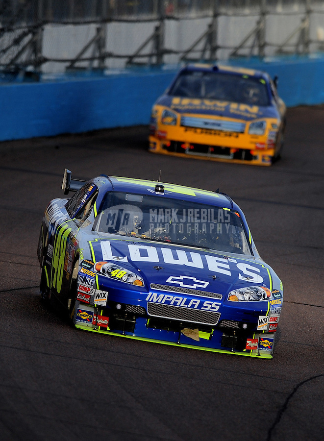 Nov. 9, 2008; Avondale, AZ, USA; NASCAR Sprint Cup Series driver Jimmie Johnson (48) leads Jamie McMurray during the Checker Auto Parts 500 at Phoenix International Raceway. Mandatory Credit: Mark J. Rebilas-