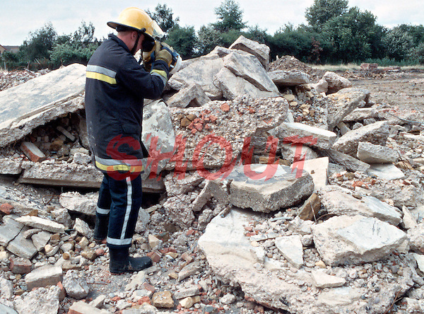 Firefighters attending an incident where a building has collapsed trapping occupants under tons of rubble. The house was ripped apart by an explosion. The blast totally destroyed the two storey building. This image may only be used to portray the subject in a positive manner..©shoutpictures.com..john@shoutpictures.com