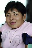 KAZ / Kasachstan / Almaty / 27.07.213 / Portrait der 35jährigen Arzu Almassova mit Glasknochenkrankheit. Deshalb läuft sie an Krücken. Sie ist Unternehmerin und betreibt zwei Schönheitssalons und ein Kaufhaus. / Portrait of 35 years old Arzu Almassova. She was diagnosed with brittle bone disease, Osteogenesis imperfecta, shortly after birth. That's why she walks on crutches. Nevertheless she runs two hairdresser's and manicure shops and a department shop